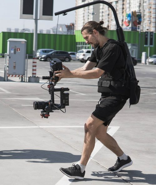 Image of our staff at  Elite Video of West Palm Beach Beach Beach shoowing some footage out in a parking lot.
